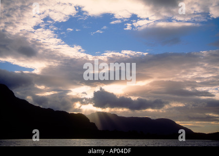 SUNSET over the TEMPERATE RAIN FOREST of NORTHERN PATAGONIA as it meets the PACIFIC OCEAN CHILE - Stock Photo