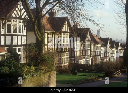 Holly Lodge Estate, Highgate, North London, UK Street of detached suburban  houses sloping down hill mock tudor - Stock Photo