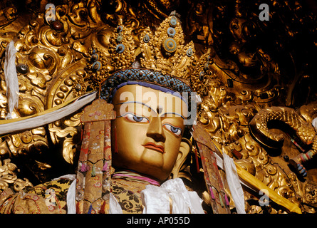 Beautiful JEWEL ENCRUSTED STATUE OF MAITREYA future Buddha in the MAIN ASSEMBLY HALL at DREPUNG MONASTERY - Stock Photo