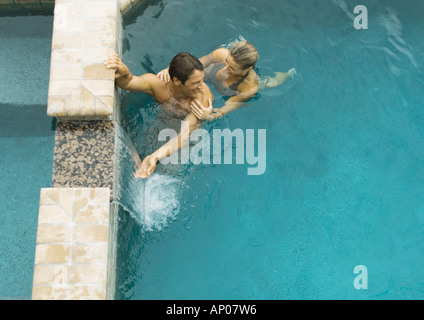 Couple in swimming pool, high angle view - Stock Photo