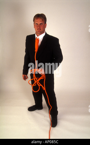 Necktie party going to work with a noose around your neck man tied up and in danger from himself suicide self abuse - Stock Photo
