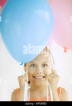 Girl holding balloons - Stock Photo