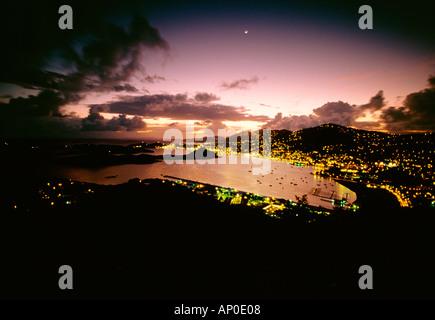 Lights Of Charlotte Amalie Bay At Dusk Purple Sky Shadowy Clouds St Thomas US Virgin Islands - Stock Photo