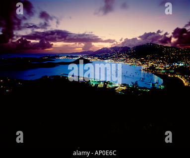 Lights of Charlotte Amalie Bay At Dusk with Purple Sky and Clouds St Thomas US Virgin Islands - Stock Photo
