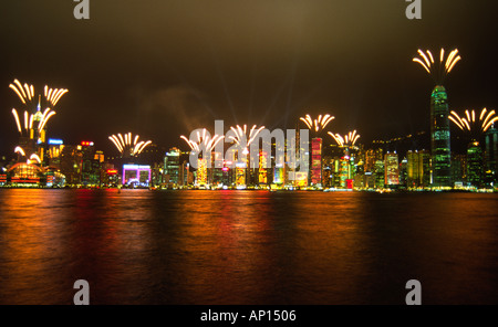 Fireworks light the Hong Hong skyline during the Chinese New Year holiday period - Stock Photo