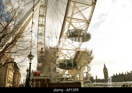 The Millennium Wheel London Eye With Big Ben and The Houses of Parliament In The Background - Stock Photo