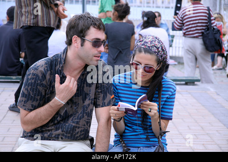 couple from different cultures trying to communicate - Stock Photo