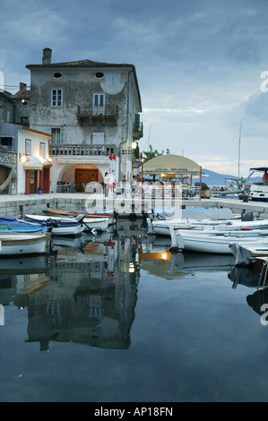Harbour and boats in the evening light, Valun, Cres Island, Croatia - Stock Photo