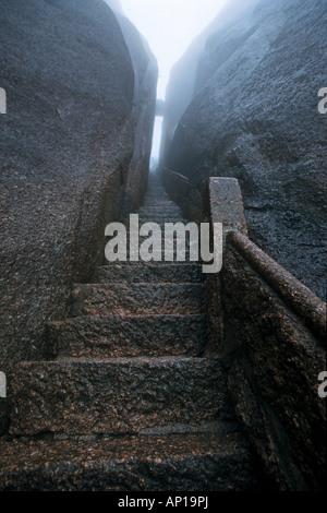 steep rock carved stone steps to Jade Screen Peak, Huang Shan, Anhui province, steep climb, stone steps, World Heritage, - Stock Photo