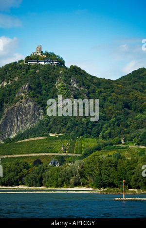 DRACHENFELS AND VISTORS CENTRE ABOVE RHINE NEAR BONN GERMANY AS SEEN FROM THE RIVER RHINE - Stock Photo