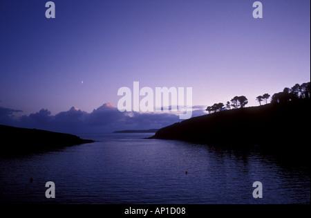 moonrise over sandy cove looking towards old head lighhtouse near kinsale county cork Ireland eire - Stock Photo