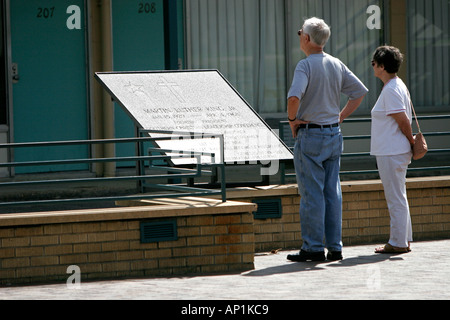 Visitors view memorial plaque commemorating Dr Martin Luther King Jr Lorraine Motel Memphis USA