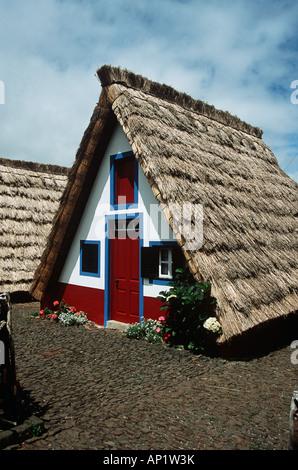 Typical triangular A framed house, Santana, Madeira - Stock Photo