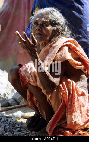 India: old woman from the cast of the untouchables working in a quarry near Madurai - Stock Photo