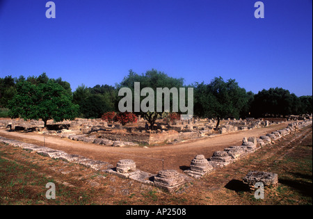 Column bases of the Ionic colonnade that surrounded the Leonidaion in Olympia a sanctuary of ancient Greece in Elis - Stock Photo