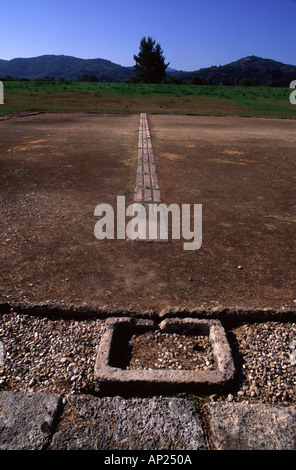 The starting line of the ancient Stadium in Olympia a sanctuary of ancient Greece in Elis on the Peloponnese peninsula, - Stock Photo