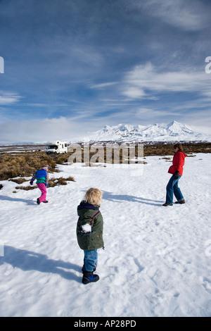 Snowball Fight Rangipo Desert and Mt Ruapehu Central Plateau North Island New Zealand - Stock Photo