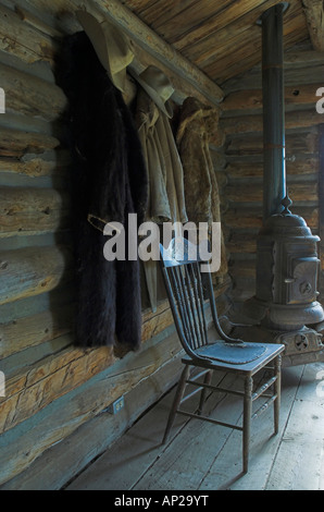 Coats and hats hanging inside a restored cabin in the wild west town of Cody Wyoming USA - Stock Photo