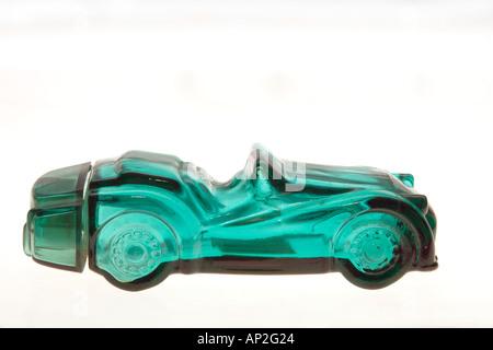 Perfume Bottle in shape of car on white background - Stock Photo