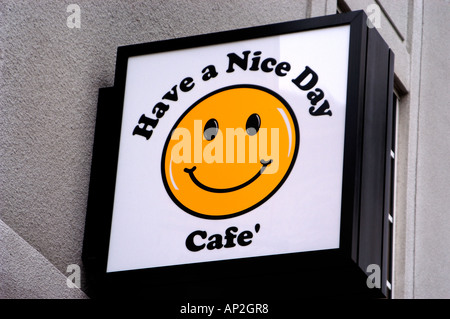 Sign on building Have a Nice Day Cafe - Stock Photo
