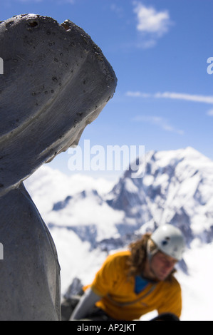 Man on the summit of Dent de Geant, 4013 m, south face, Mont Blanc, France, Italy - Stock Photo