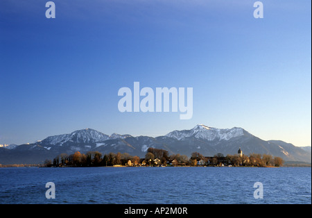 Lake Chiemsee with island of Frauenchiemsee and snow-covered Hochfelln and Hochgern, Gstadt, Chiemgau, Upper Bavaria, - Stock Photo