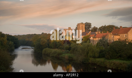 A morning view of West Tanfield village looking across the River Ure in North Yorkshire UK - Stock Photo