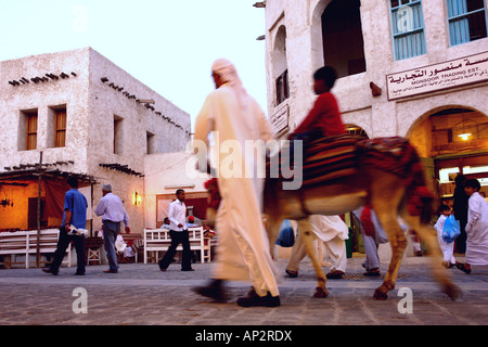 Man with child on donkey, Traditional Souk in Doha, Qatar - Stock Photo