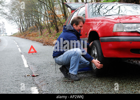 Man with Puncture on Car. - Stock Photo