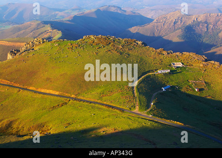 Mountains and sheep farm in the evening light, Bosque del Irati, Pyrenees, Navarra, Spain - Stock Photo