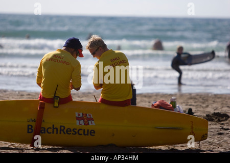 Lifeguards on duty at a crowded public beach - Stock Photo