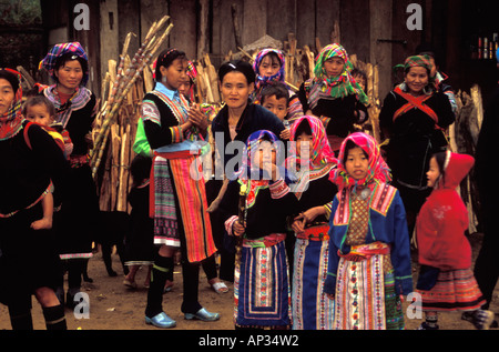 Group of Flower Hmong villagers at side of road (taken from passing car) on the way to Dien Bien Phu, north Vietnam - Stock Photo