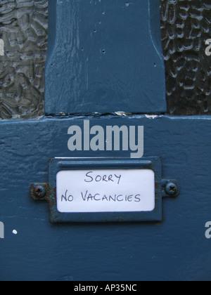 sorry no vacancies notice on hostel door - Stock Photo