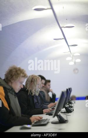 Students working on computers in the Uni Lounge, University, Ludwig Maximilians Universitaet, Munich, Bavaria, Germany - Stock Photo
