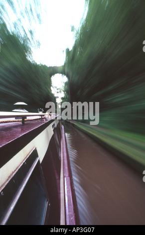 PICTURE CREDIT DOUG BLANE narrowboat navigating along the canal - Stock Photo