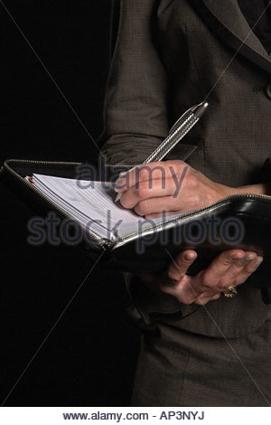 Businesswoman with organiser - Stock Photo
