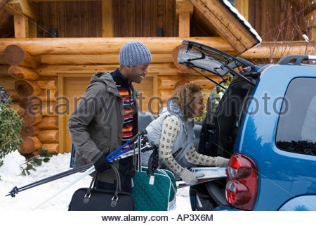 Couple packing car boot - Stock Photo