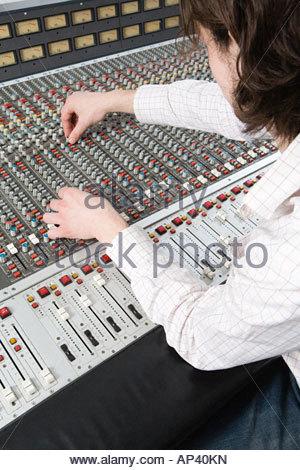 Man using mixing desk - Stock Photo