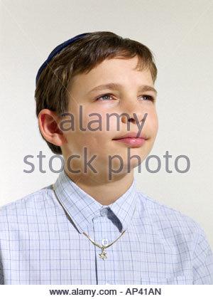 Jewish boy wearing a kippah - Stock Photo