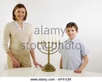 Mother and son with menorah - Stock Photo