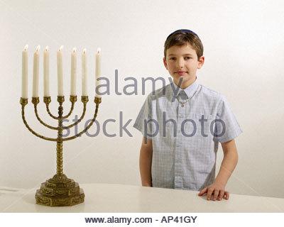 Jewish boy with menorah - Stock Photo
