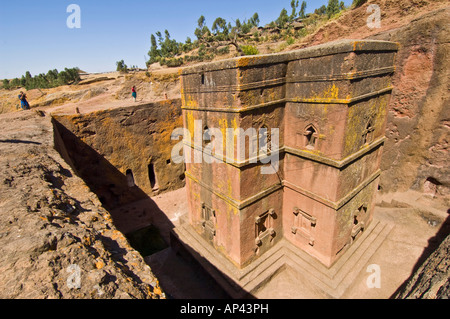 Two tourists taking photographs at the Bete Giyorgis or Church of St. George monolithic church in Lalibela. - Stock Photo