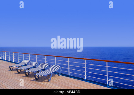 Lounging chairs in a row - Stock Photo