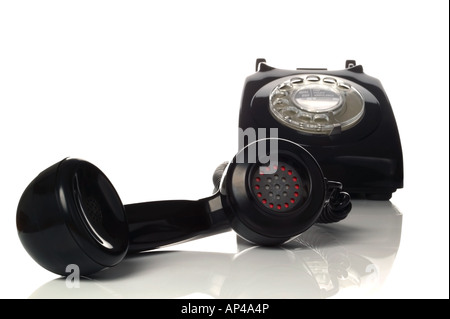 Retro black phone with focus on the handset in the foreground - Stock Photo