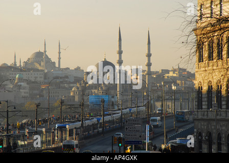 ISTANBUL. Looking from Karakoy in Beyoglu across the Galata Bridge to Eminonu and the Yeni and Nuruosmaniye Mosques. - Stock Photo
