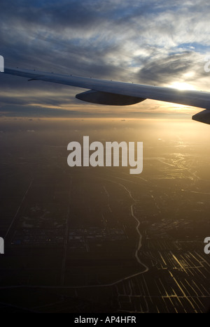 view from the window of a KLM Boeing 777 as it comes in to land at Amsterdam Shiphol airpor - Stock Photo