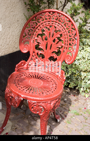Phenomenal Red Painted Wrought Iron Chair Outside Restaurant At Dunster Machost Co Dining Chair Design Ideas Machostcouk