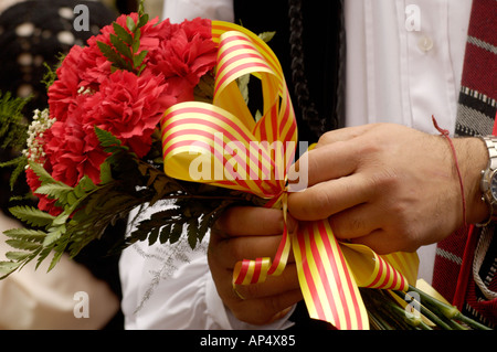 Man carrying flowers in the fiesta del Pilar, Zaragoza,Spain - Stock Photo