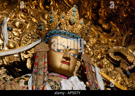 Beautiful JEWEL ENCRUSTED STATUE OF MAITREYA the future Buddha in the MAIN ASSEMBLY HALL at DREPUNG MONASTERY LHASA - Stock Photo