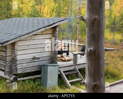 block cabin refugee with fire place for a pause at a trecking route in landscape in Pallas Yllästunturi nationalpark - Stock Photo